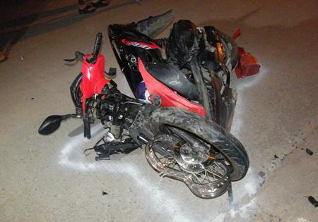 The new motorbike was hardly recognizable after the youngster driving it hit a pickup truck head on.
