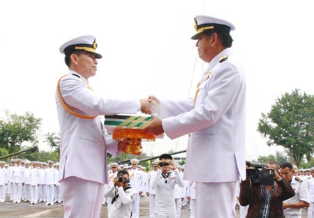 ACDC chief Rear Adm. Noppadol Suphakorn hands over administrative documents to Rear Adm. Luechai Ruddit, bestowing command of the Air and Coastal Defense Command in Sattahip.
