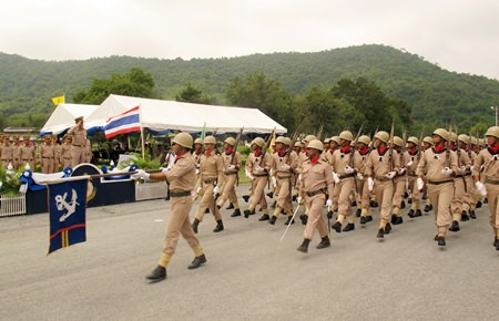 Cadets who graduated from the Naval Recruit Training Center in Bang Saray, taking up service as Royal Thai Marines, march past their commanding officer.