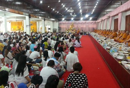 Buddhists offer alms at Wat Chaimongkol Phra Aaramluang, South Pattaya.