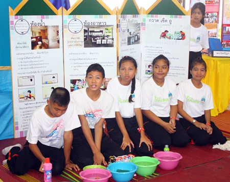 Students at Pattaya School #8 tend one of the booths set up as part of the school's 86th anniversary and exhibition on the ASEAN Economic Community.