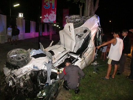 It's hard to believe anyone could have survived this crash, but apparently Surapol Subcharoen did.  He was still inside when this photo was taken.