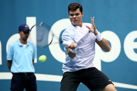 Raonic powers a forehand past Berdych in the final.