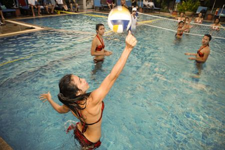 Ladyboy water-volleyball returning to Areca Lodge, Soi Diana on October 26.