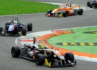 Sandy Stuvik (bottom) steers his car through the chicane while leading at the Monza Circuit in Italy, Sunday, Oct. 6.