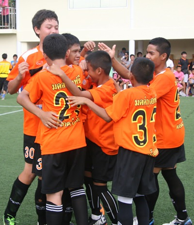 Pattaya team Black Ant FC celebrate after winning a penalty shoot-out.
