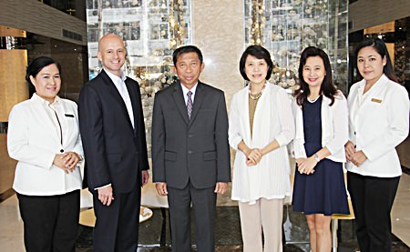 Dominique Ronge (2nd left), general manager of Centara Grand Phratamnak Pattaya and Kanokros Sakdanares (2nd right), corporate director of marketing communications of Centara Hotels & Resorts, welcome Admiral Taweewuth Pongsapipatt (3rd left), Chief of Staff, Royal Thai Navy and his wife, Captain Doctor Woranart Pongsapipatt, Royal Thai Navy (3rd right) on their arrival to stay at the newly opened resort as the first guests. The hotel soft opened on 15th October. Also seen in the photo are Wassana Pokthang (far left), executive assistant manager and Chananchida Wongsa-ard (far right), sales and public relations manager of Centara Grand Phratamnak Pattaya.