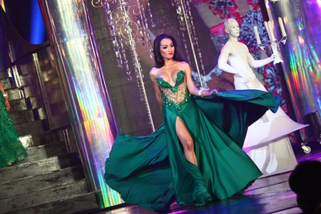 Angeline Hanum from Indonesia walks confidently in a green gown during the evening gown portion of the show.