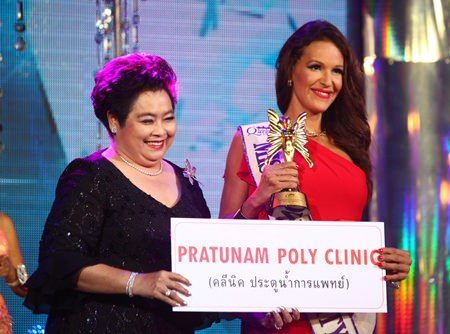 Spanish contestant, Carolina Medina (right), smiles for the cameras after winning the Miss Congeniality award.