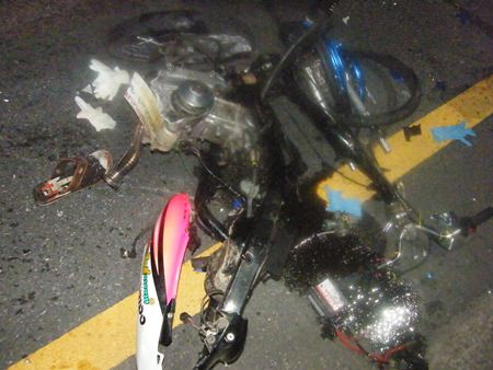 This motorbike is almost unrecognizable after the collision.  The other (not shown) was also clearly demolished.