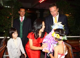 HE Ambassador Enno Drofenik and his family and consul general Hofer are greeted by the children of the CPDC.