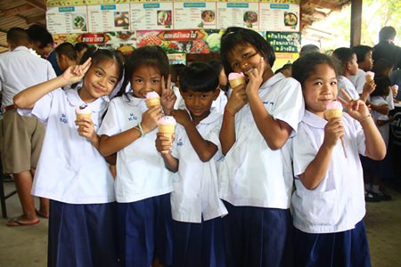 Children smile brightly whilst enjoying their favorite ice cream given to them by Hard Rock Hotel Pattaya & Hard Rock Cafe Pattaya.