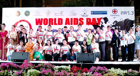 "Officials and friends take to the stage on World AIDS Day, announcing the new policy ""Getting to zero""."