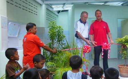 William and Woody cut the ribbon.