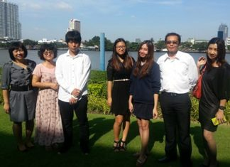 Sarah and Yeen, together with their families, at the Cambridge Outstanding Learner Awards in Bangkok.
