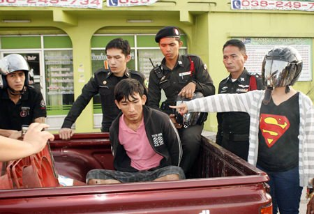 Surasak Multhin (shown here handcuffed in the back of the police pickup) claimed it was his first attempt at bag snatching.