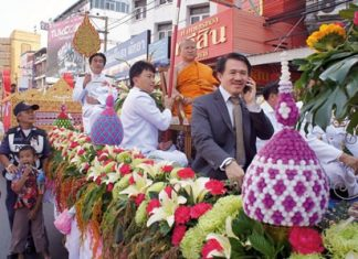 "Surat Mekavarakul joins local Buddhists in a parade to honor the royal proclamation bestowing Abbot Panyaratanapon with the title ""Phra Racha Khana Chan Saman""."