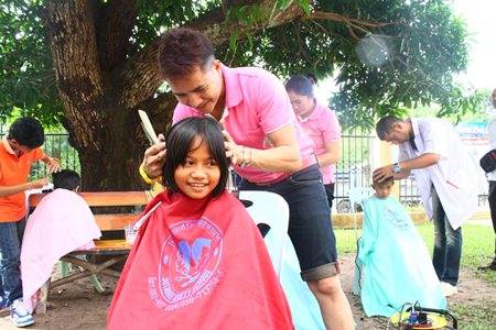 Children are truly enjoying hair treatments from Jutamat Beauty School beauty technicians.