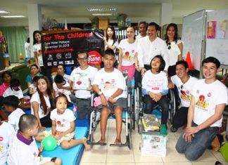 Tune Hotels Pattaya executives and employees brought toys, clothing and cash donations to the Redemptorist Center for Children with Special Needs.
