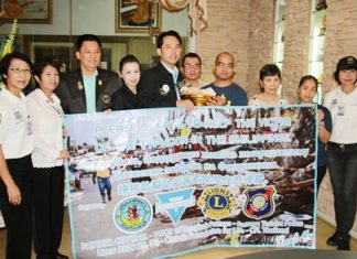 Mayor Itthiphol Kunplome (center), representing Pattaya charity groups, presents a large donation to Yu-een Khapis (4th right) from the Couples for Christ Faith Family Life, to help Philippine victims of Typhoon Haiyan.