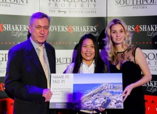 A winning smile: Kingdom Property CEO Nigel Cornick (left) and Vice President of Marketing Irina Breslavtseva (right) pose with Ananya Puangkulab (centre), one of the winners of the company's naming competition for Mustique, Wong-Amat Beach.