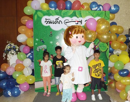 Children pose for a photo with the Bangkok Hospital Pattaya nurse mascot.