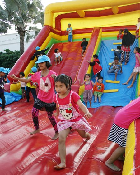 The bouncy slide is always a major attraction on Children's Day.