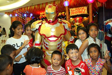 Children are excited to take pictures with their favorite hero, Ironman.
