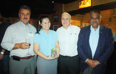 (L to R) Michael Diamente from Dana Spicer, Suratchada Chaivorawat, Corporate Sales Executive for Hilton Pattaya, David R. Nardone, President & CEO of Hemaraj Land and Development PCL and Peter Malhotra, MD of Pattaya Mail Media Group.