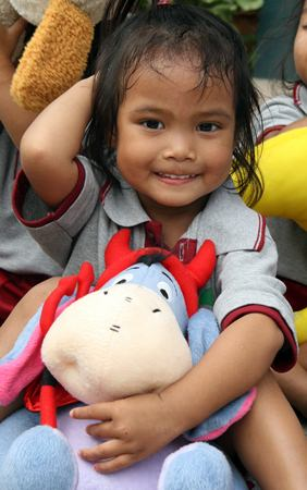 The children from the Father Ray Day Care Center were very happy with their new soft toys.