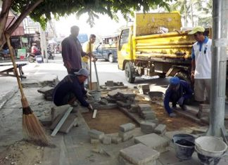 City workers are hard at work, replacing broken tiles and filling holes in the sidewalks throughout Pattaya.