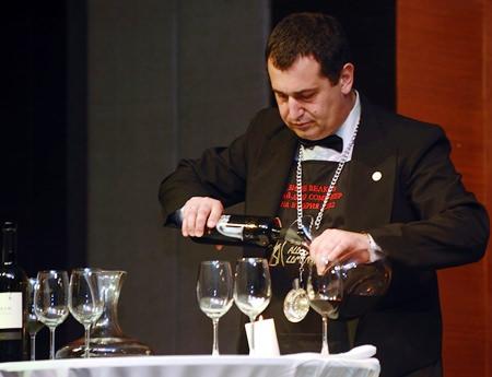 Bulgarian Sommelier Vihren Velkov expertly decants a bottle of Thracian wine.