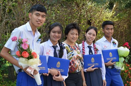 Four happy students and a very proud Miss Pom on a day the students sometimes felt would never arrive.