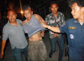 Authorities were finally able to extract the crazed Chanok Suwan from his house after his failed suicide attempt.
