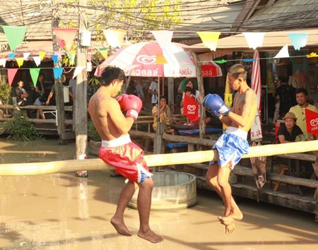 "Pugilists get set to begin a ""Muay Talay"" (sea boxing) match at Pattaya Floating Market."