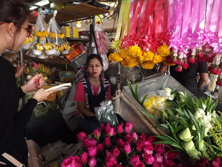 Kan Janwichian sells pink and red roses at prices starting at 20-25 baht at her flower stand at the Chaimongkol Temple market in South Pattaya.
