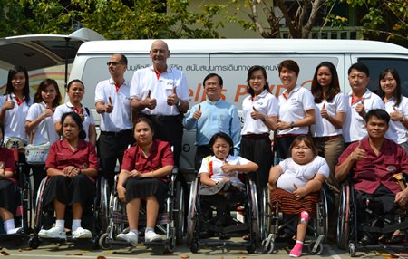 FWD Life Insurance Co. CEO Mike Plaxton (center) led his company to donate 10 wheelchairs to the Redemptorist Vocational School for Persons with Disabilities.