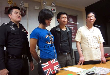 Transvestite prostitute Anusorn Chaiyong (2nd left) was caughtafter pick-pocketing a Chinese tourist.