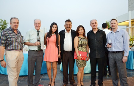 (L to R) Rene E.H. Pisters, GM of the Thai Garden Resort Pattaya; Dr Iain Corness; Nattakarn Sinprasom; Peter Malhotra, Managing Director of the Pattaya Mail Media Group; Ploy Pisters, Luciano Lillus, General Manager of the Sunshine Hotels & Resorts Pattaya; and Danilo Bockert, Deputy General Manager of the Thai Garden Resort Pattaya getting ready for the Skål meeting.