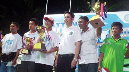 Itthiphol Kunplome, mayor of Pattaya city, presents trophies to the winners.