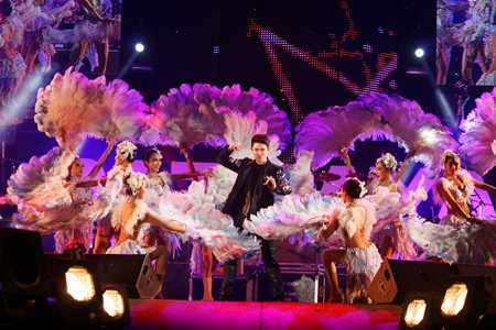 The prince of country, Got Jakapan, surrounded by majestic costumes.
