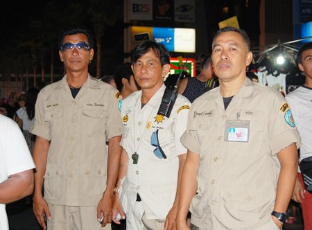 Civil defense officers maintaining peace and order and helping tourists at the event.