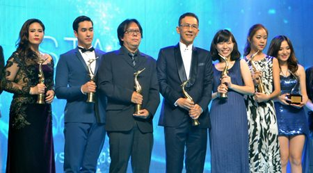 Popular movie directors and actors/actresses pose with their Golden Swan awards.