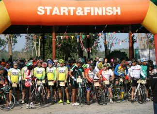 Cyclists assemble at the starting line.