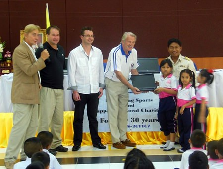 The laptops are presented to the children.