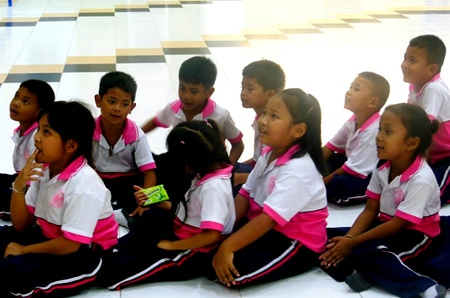 A group of children wait patiently.