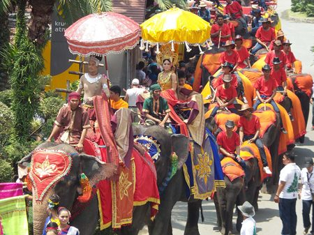 The parade of elephants makes its way towards the feasting grounds.