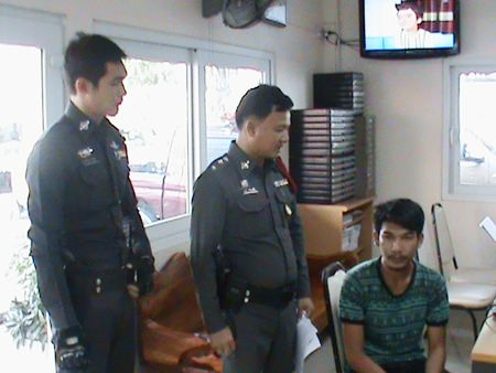 Police say Supparuek Topa (seated, right) has confessed to stealing a South African expat's car and more than 100,000 baht in cash and electronics.