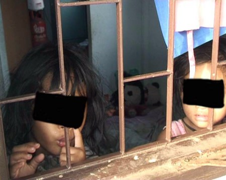 Police found the 2- and 4-year-old girls alone, inside their filthy Sukhumvit Soi 3 home.