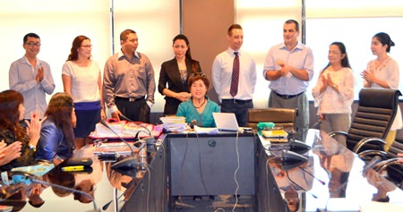 Sirina Khainongsuang (seated, center), franchisee for My First English Adventure in Thailand, and teachers from local schools applaud the use of the effective teaching tool.